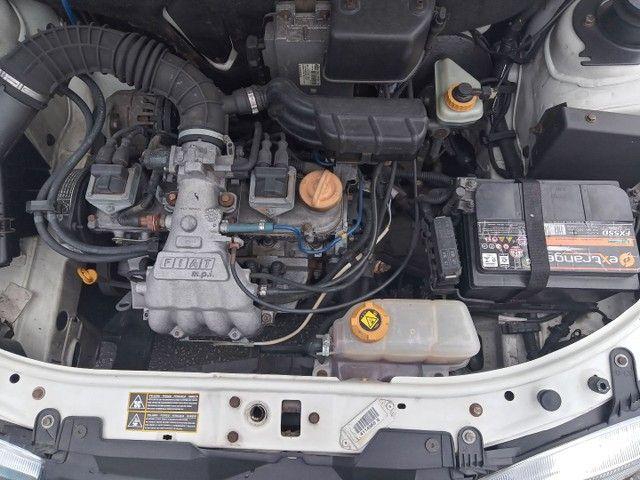 Vendo pálio carro de garagem com 40 kl rodados original - Foto 13