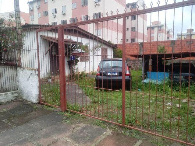 Terreno com 3 casas/ótimo investimento - Foto 2