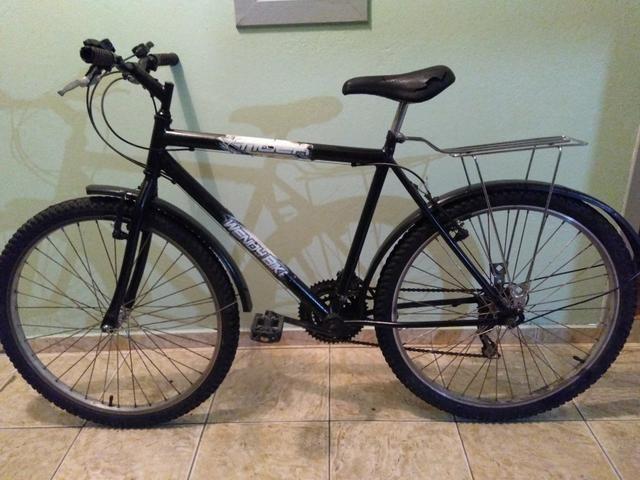Vendo bicicleta masculina 18 marchas em ótimo estado contato whatsapp 998897865