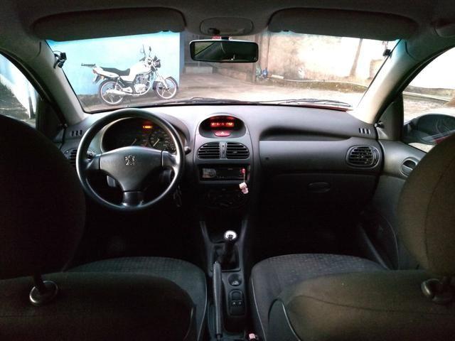 Peugeot 206 ano 2007 1.4 flex com manual nota fiscal de fábrica e chave reserva - Foto 11