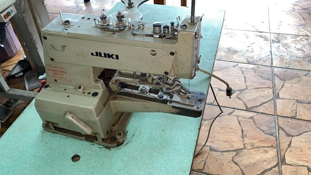 Maquina de pregar botao