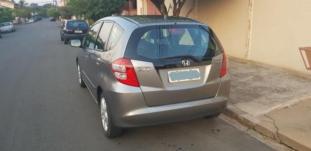 Honda Fit LXL 2010 - ipva total pago - Foto 5