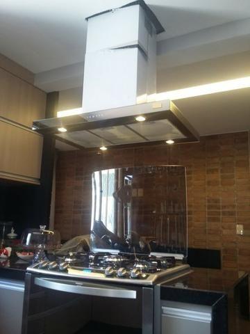 Instalação de coifa/fogão e triturador