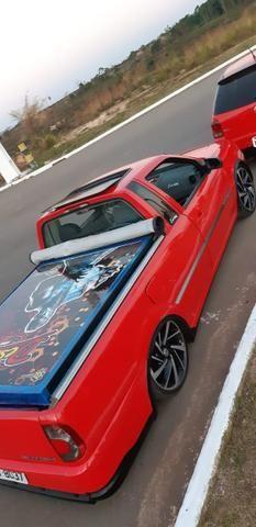 Saveiro G4 2009/2009 titan com som automotivo