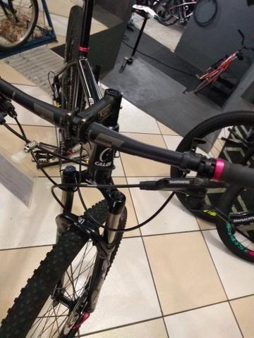 Bicicleta aro 29 Caloi,kit XT suspensão vc a ar - Foto 6