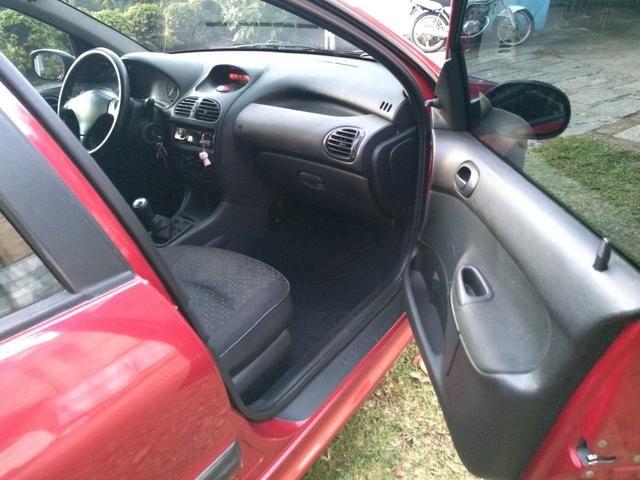 Peugeot 206 ano 2007 1.4 flex com manual nota fiscal de fábrica e chave reserva - Foto 9