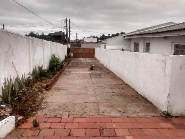 Terreno com 1100 m² contendo 3 residencias em alvenaria oferta ótimo investimento - Foto 9