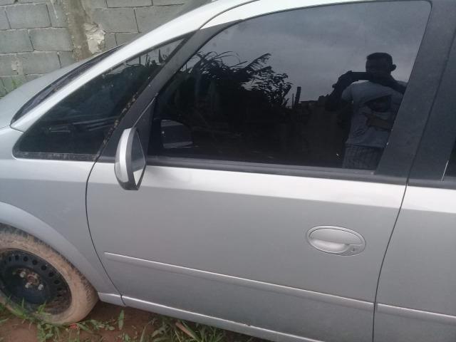 Porta dianteira L esquerdo e direito completa sem retrovisor meriva usada original