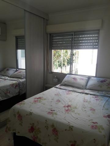 Apartamento 2 dormitórios semi mobiliado com vaga de estacionamento - Foto 9