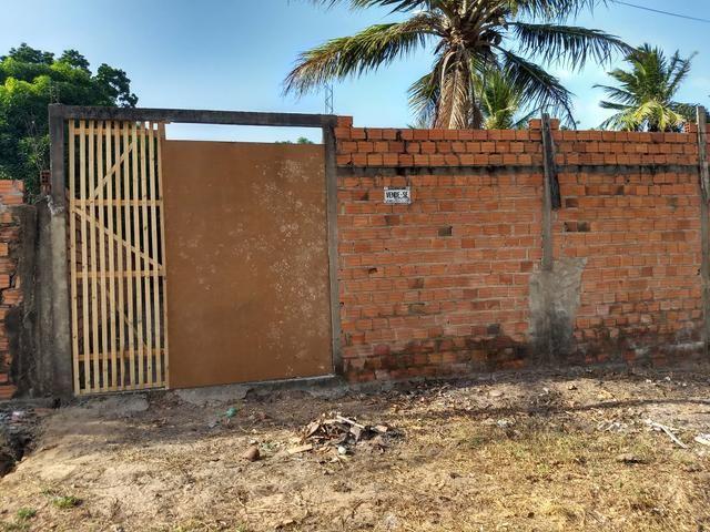 Vendo terreno 12 x 40 com alicerces, todo murado