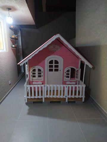 Casinhas de bonecas e balanços infantis