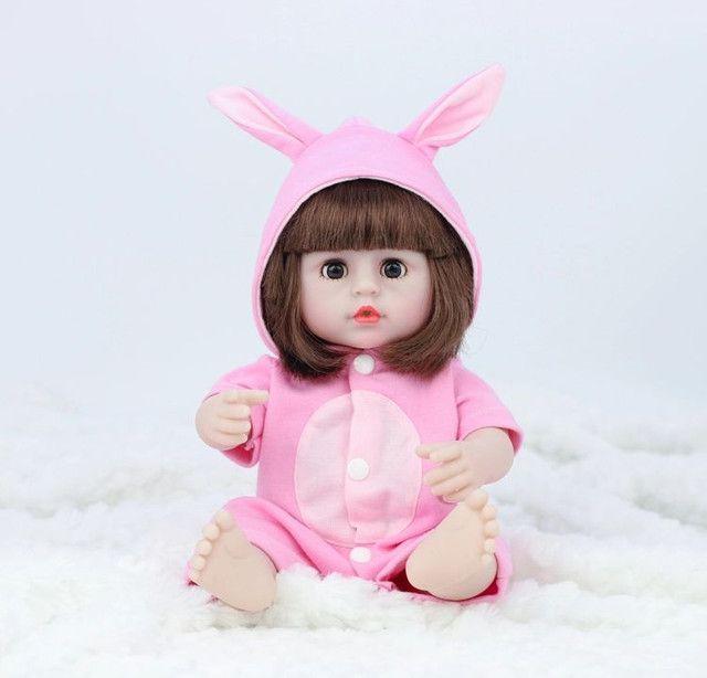Boneca Reborn Toda Em Silicone Faz Xixi 38cm - Foto 3