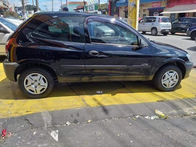 Gm - Chevrolet Celta Entrada 1500 financie com score baixo - Foto 5