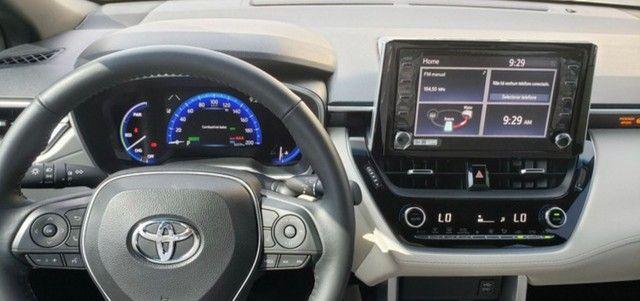 Corolla Cross Altis 2022 Hybrid - BLINDADO - 6 mil km - Douglas 9 8 3 2 8 7 1 1  - Foto 5