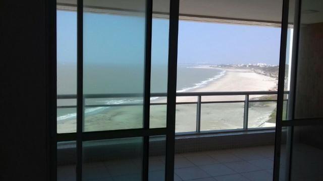 Alugo apto com 4 suites na frente do mar