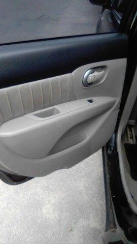 Excelente Nissan Livina - Foto 9