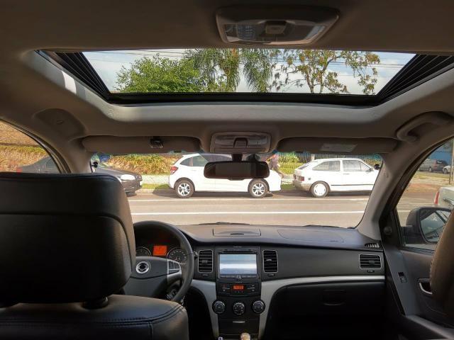 Korando 2.0 diesel aut 4x4 com teto - Foto 8