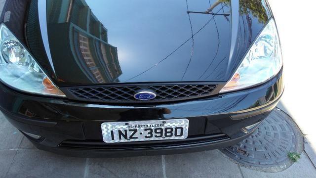 Focus Hatch GLX 2.0, 91 mil km, particular, nunca bateu, motor Duratec 147 cv - Foto 4