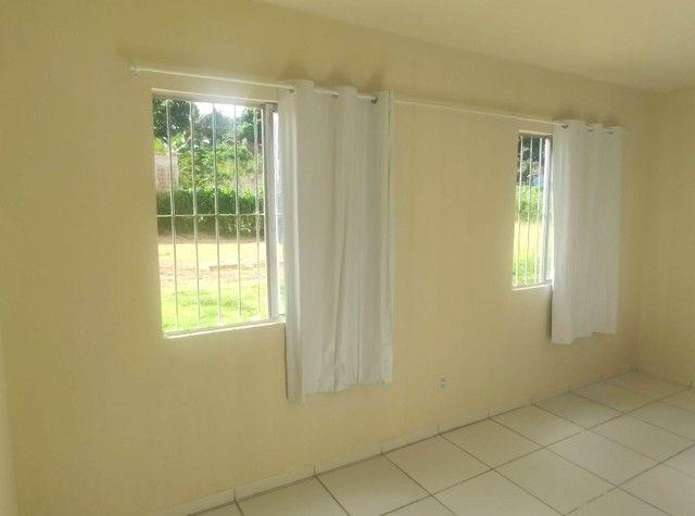 Alugo Apartamento Térreo 2 Quartos, Sala 2 Ambientes, Cozinha, Área de serviço e Banheiro. - Foto 3