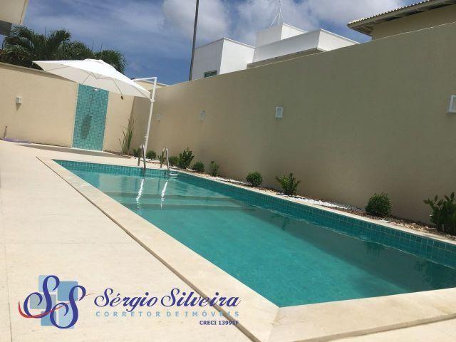 Espetacular Casa no Alphaville Eusébio com 4 suítes piscina, churrasqueira,fino acabamento