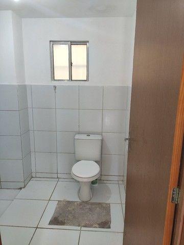 Alugo Apartamento Térreo 2 Quartos, Sala 2 Ambientes, Cozinha, Área de serviço e Banheiro. - Foto 2