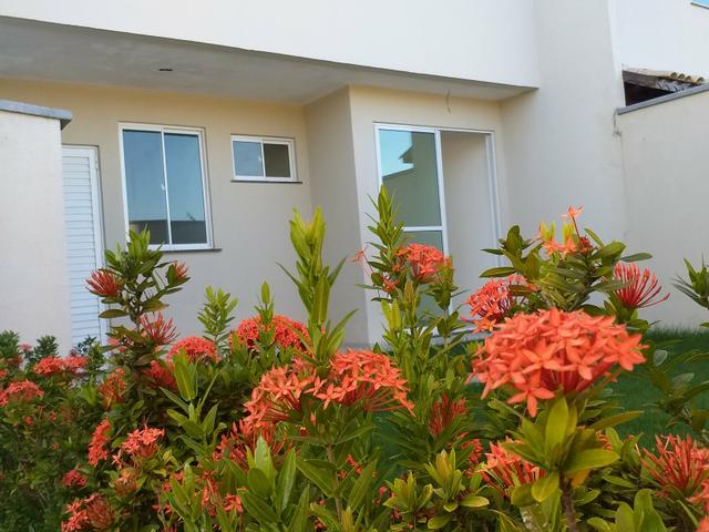 Linda casa em condomínio com ótima localização - Foto 6