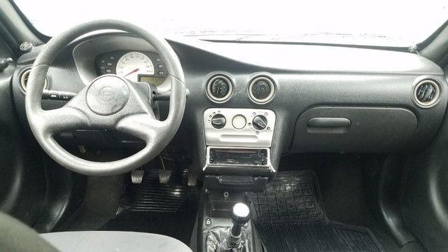 GM Celta 1.0 com vidros e travas elétricas. Carro bom e barato. Confira! - Foto 9