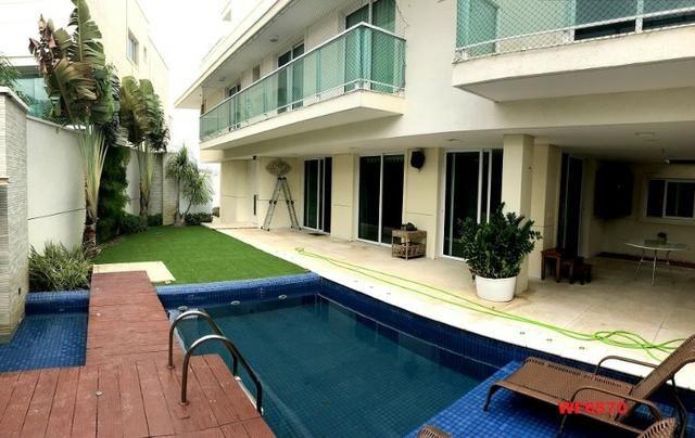 Condomínio Stellarium, casa tríplex com 5 suítes, 8 vagas de garagem, Elevador