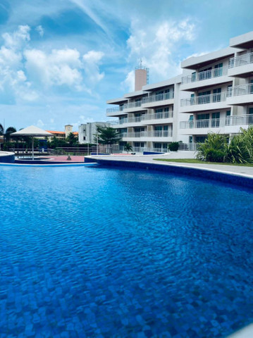 Apartamento três quartos, alto padrão, lazer completo, Porto das Dunas!