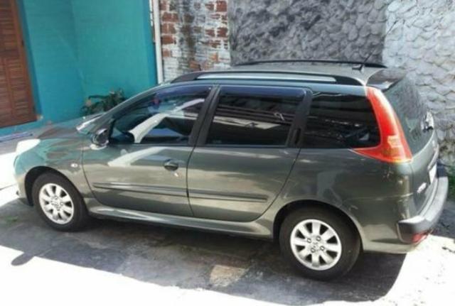 Peugeot 207 Sw 1.4 2010 já financiado não precisa transfetir carnê R$ 8.200 entrada - Foto 2