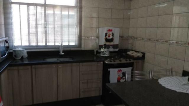 Ótima residência c/ 04 quartos, amplo terreno e salão de festas em Uvaranas !!! - Foto 15