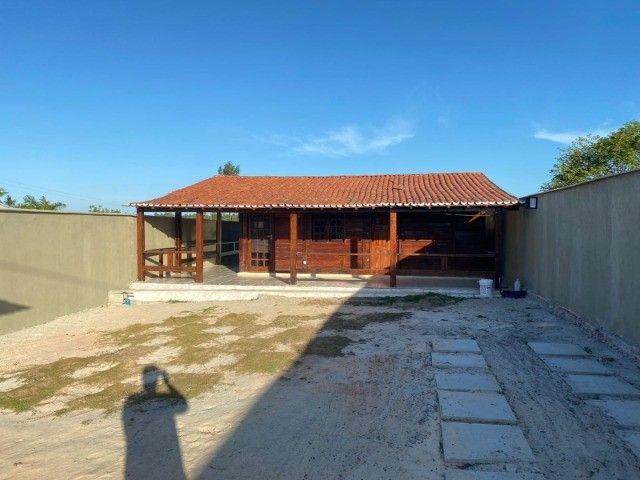 Casa de Madeira a 600 metros da CE-040 com terreno 400 m2 e deck preço de ocasião - Foto 2
