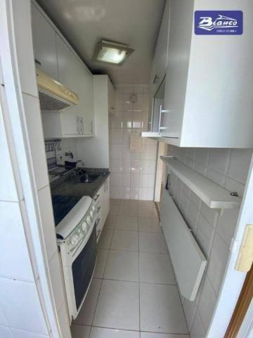 Apartamento com 2 dormitórios para alugar, 50 m² por R$ 900,00/mês - Vila Augusta - Guarul - Foto 4