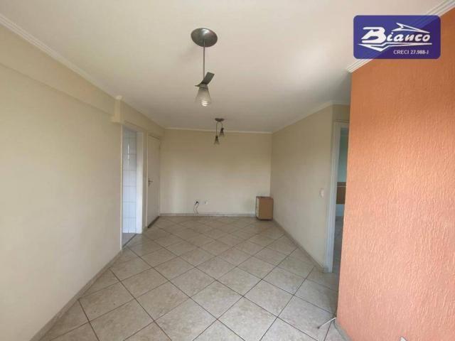 Apartamento com 2 dormitórios para alugar, 50 m² por R$ 900,00/mês - Vila Augusta - Guarul - Foto 2