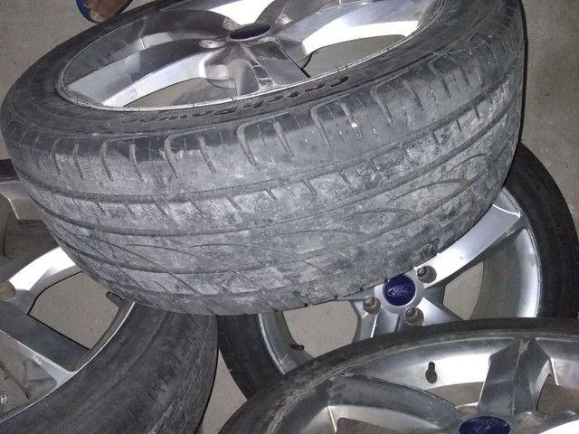 Vendo jogo completo pneu 235/45/18 furacão 4/100 aceito cartão - Foto 3