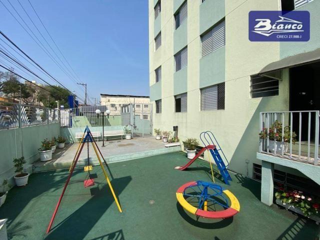 Apartamento com 2 dormitórios para alugar, 50 m² por R$ 900,00/mês - Vila Augusta - Guarul - Foto 11