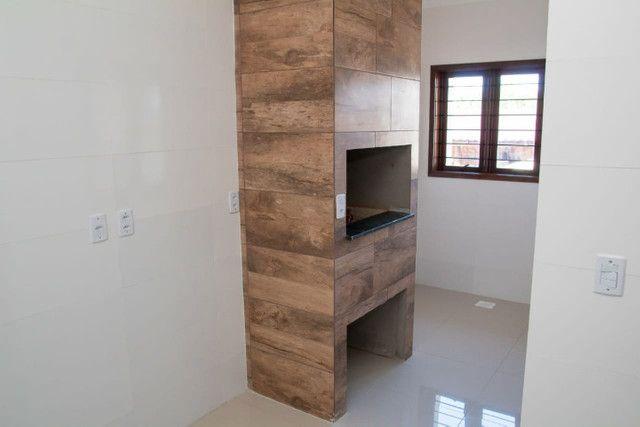 Excelente casa com 03 quartos, 02 vagas de garagem em Santa Rosa-RS - Foto 5