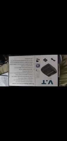 Impressora térmica portátil com bluetooth + 20 bobinas  - Foto 4