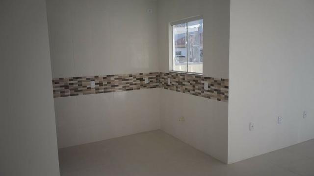 Casa terrea 2dorm 1suite C/estrutura segundo piso em otima localização - Foto 12