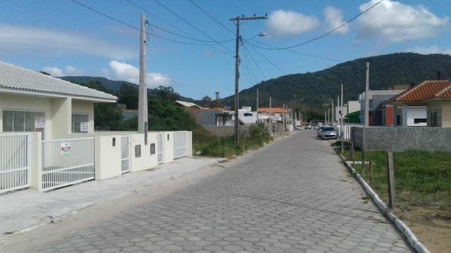 Casa terrea 2dorm 1suite C/estrutura segundo piso em otima localização - Foto 2