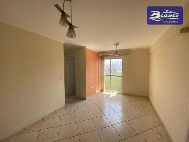 Apartamento com 2 dormitórios para alugar, 50 m² por R$ 900,00/mês - Vila Augusta - Guarul