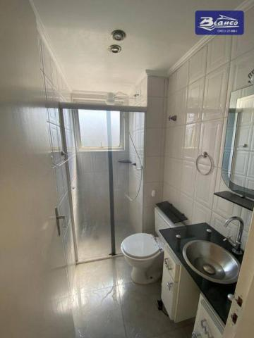 Apartamento com 2 dormitórios para alugar, 50 m² por R$ 900,00/mês - Vila Augusta - Guarul - Foto 9