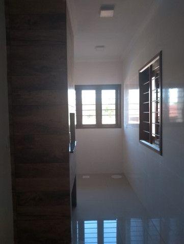 Excelente casa com 03 quartos, 02 vagas de garagem em Santa Rosa-RS - Foto 12