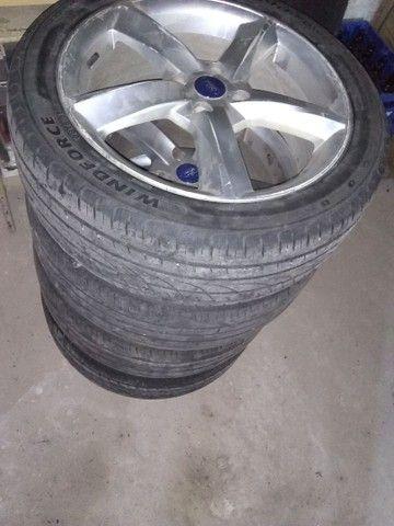Vendo jogo completo pneu 235/45/18 furacão 4/100 aceito cartão - Foto 5