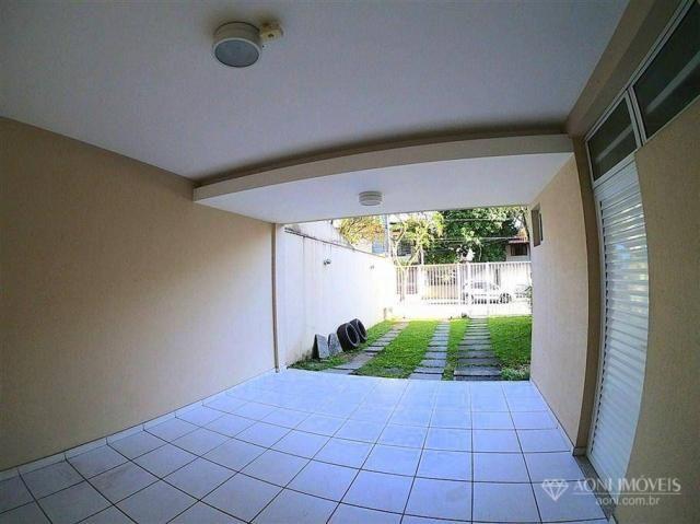 Casa duplex com 4 dormitórios, sol da manhã, lazer com churrasqueira e quintal, 3 vagas de - Foto 6