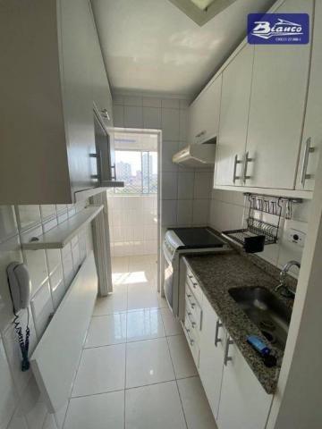 Apartamento com 2 dormitórios para alugar, 50 m² por R$ 900,00/mês - Vila Augusta - Guarul - Foto 3