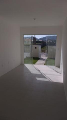 Casa terrea 2dorm 1suite C/estrutura segundo piso em otima localização - Foto 13