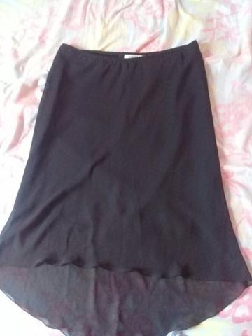 Vendo saias e vestidos usados mas em bom estado tanho outros além desses - Foto 4