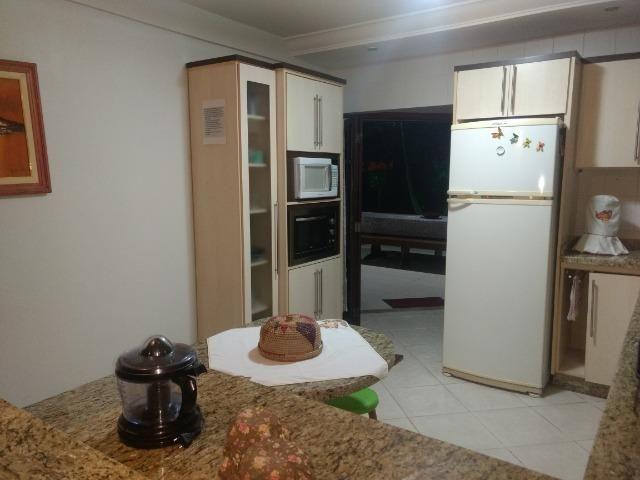 Casa e apartamento 50 mts da (Praia Enseada) c/ar e internet - Foto 18