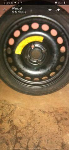 Vendo pneu com roda 9o  reais - Foto 2